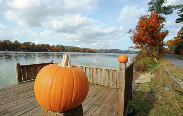 Pumpkins sit on a lakeside deck on Cossayuna Lake in Cossayuna, NY on October 26, 2010.  (Lori Van Buren / Times Union) Photo: Lori Van Buren
