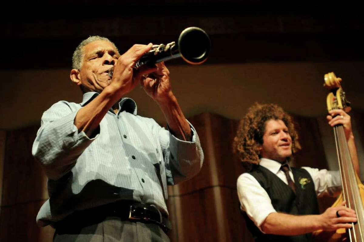 Charlie Gabriel, left, and Ben Jaffe, members of the Preservation Hall Jazz Band, perform and talk about the history of jazz with about 400 students from two area elementary schools on Tuesday, Oct. 26, 2010, at The College of Saint Rose in Albany, N.Y. (Cindy Schultz / Times Union)