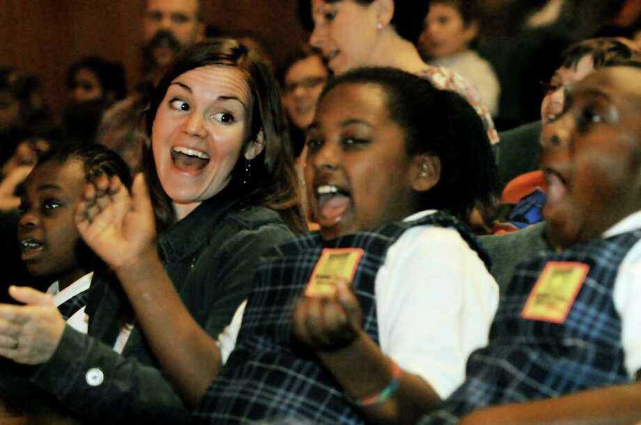 Brighter Choice Charter School for Girls teacher Helen Danciu, left, enjoys the music with her fourth-grade students when they attend a program by members of the Preservation Hall Jazz Band on Tuesday, Oct. 26, 2010, at The College of Saint Rose in Albany, N.Y. (Cindy Schultz / Times Union) Photo: Cindy Schultz