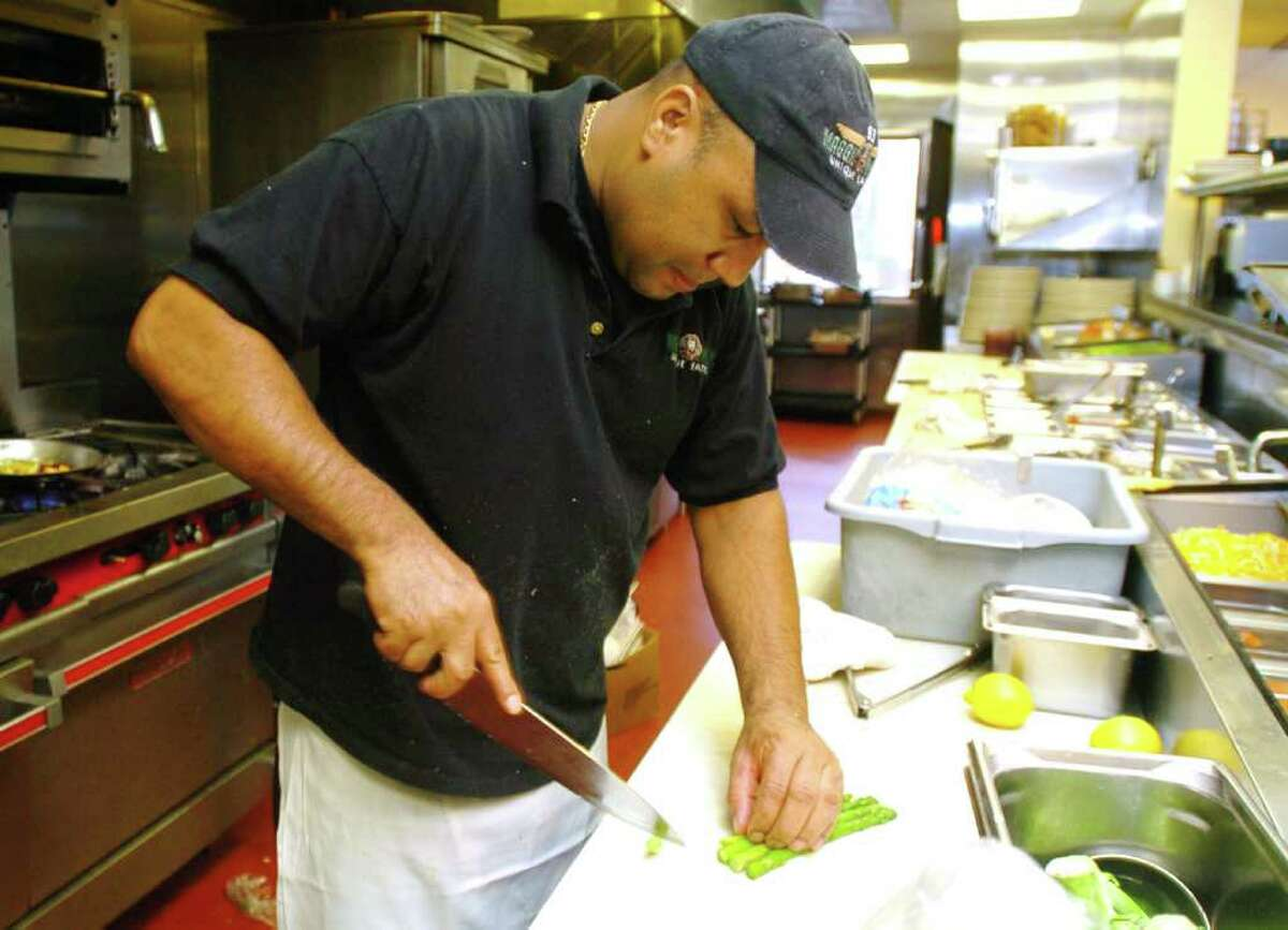 Renato Magalhaes, prepares food at Maggie McFly's restaurant in Brookfield, Oct. 20, 2010.