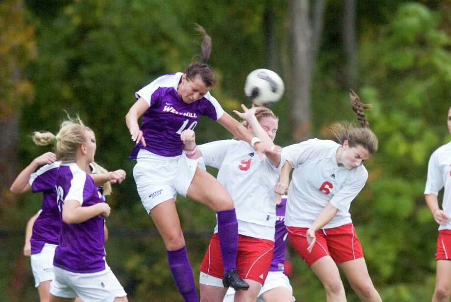 Westhill's Aulona Velaj, center, and Greenwich's Shannon Colligan and Maddie More collide as they battle for the ball as Greenwich High School hosts Westhill in a girls soccer game Tuesday, October 24, 2010. The game ended with a 1-1 tie. Photo: Keelin Daly / Stamford Advocate