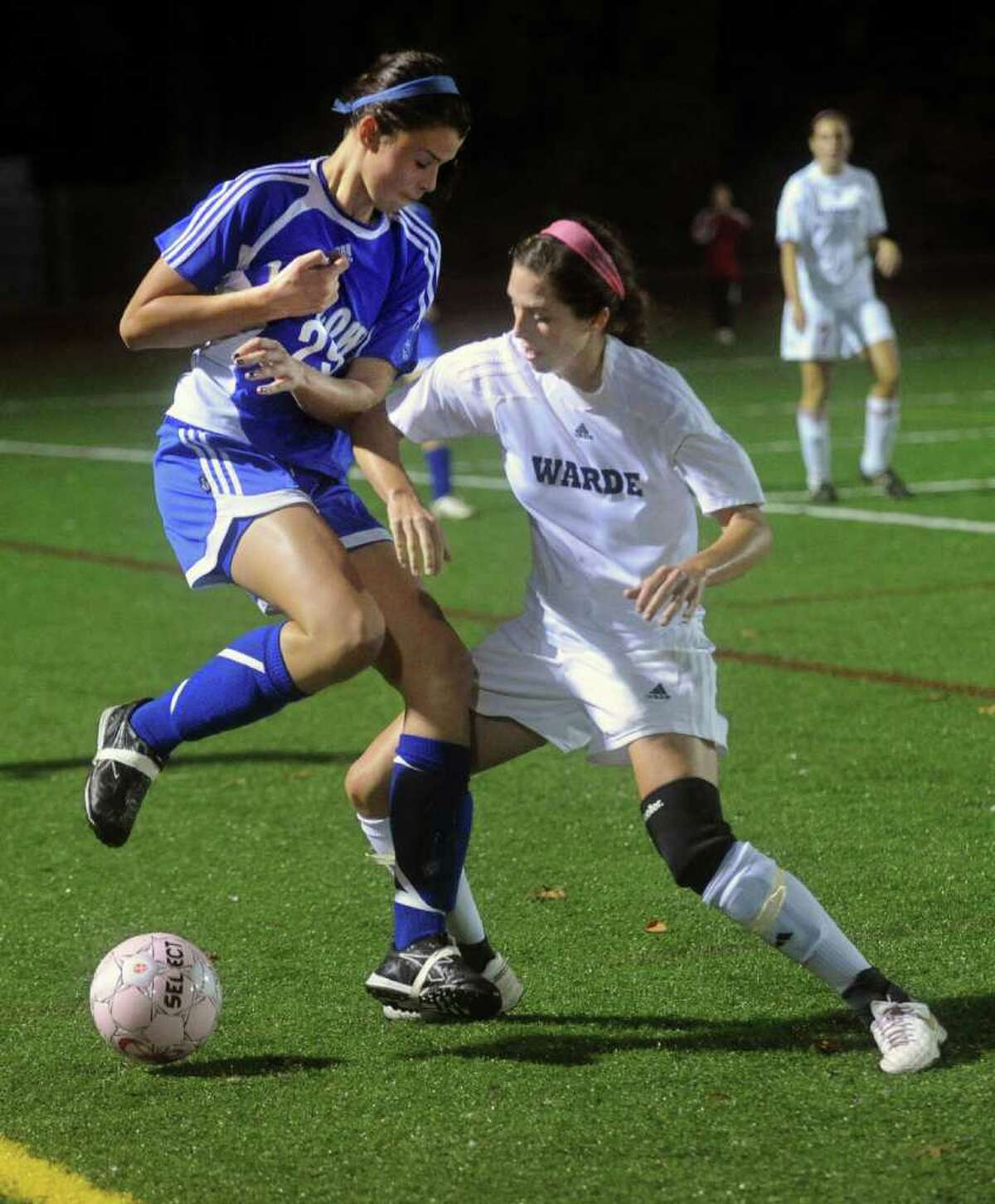 Warde's Keegan Thimons, right, and Ludlowe's Libby McNamara, left, compete for control of the ball during Tuesday's game at Fairfield Warde's field on October 26, 2010.