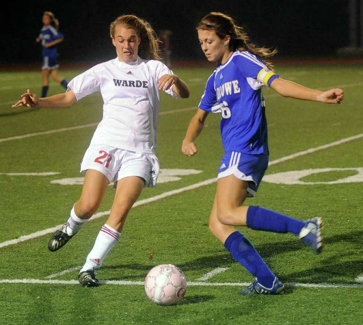 Warde's Jenny Jacob, left, and Ludlowe's Lucia Harold, right, compete for control of the ball during Tuesday's game at Fairfield Warde's field on October 26, 2010.