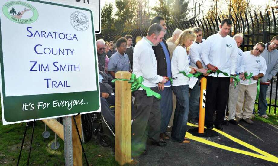 Members of the Saratoga County Supervisors cut the ribbon to open the completed Zim Smith Trail, an 8.5 mile multi-use trail from Ballston Spa to Coons Crossing in Halfmoon, during a ceremony in Ballston Spa Tuesday afternoon October 26, 2010.   (John Carl D'Annibale / Times Union) Photo: John Carl D'Annibale / 00010792A