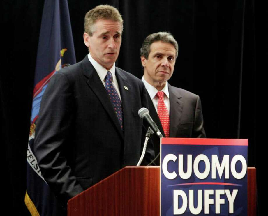 Rochester Mayor Robert Duffy, left, has executive experience as the lieutenant governor running mate selected by Andrew Cuomo, the Democratic candidate for governor.  Here Cuomo is introducing Duffy as his running mate in May. (AP Photo/Richard Drew) Photo: Richard Drew / AP