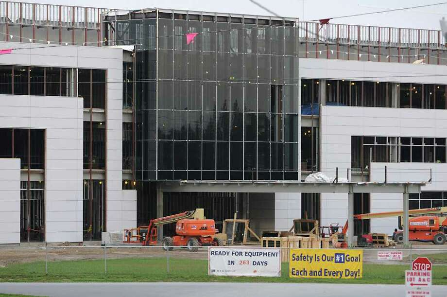 Officials at GlobalFoundries, shown here under construction at the Luther Forest Technology Campus, say state takeover of the development site will better enable future expansion.   (Lori Van Buren / Times Union) Photo: Lori Van Buren