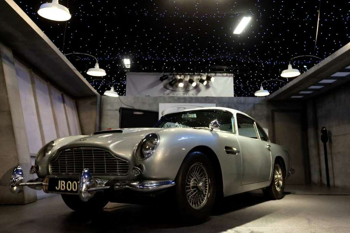 LONDON, ENGLAND - OCTOBER 27: The 1964 Aston Martin DB5 used in the Goldfinger and Thunderball films is displayed prior to featuring in the 'Automobiles of London' rare car auction in Battersea Park on Ocotber 27, 2010 in London, England. Over 100 motor cars are to be auctioned including the original Aston Martin DB5 driven by Sean Connery in Goldfinger and Thunderball James Bond films which is expected to fetch over 3.5 million GBP. (Photo by Oli Scarff/Getty Images)