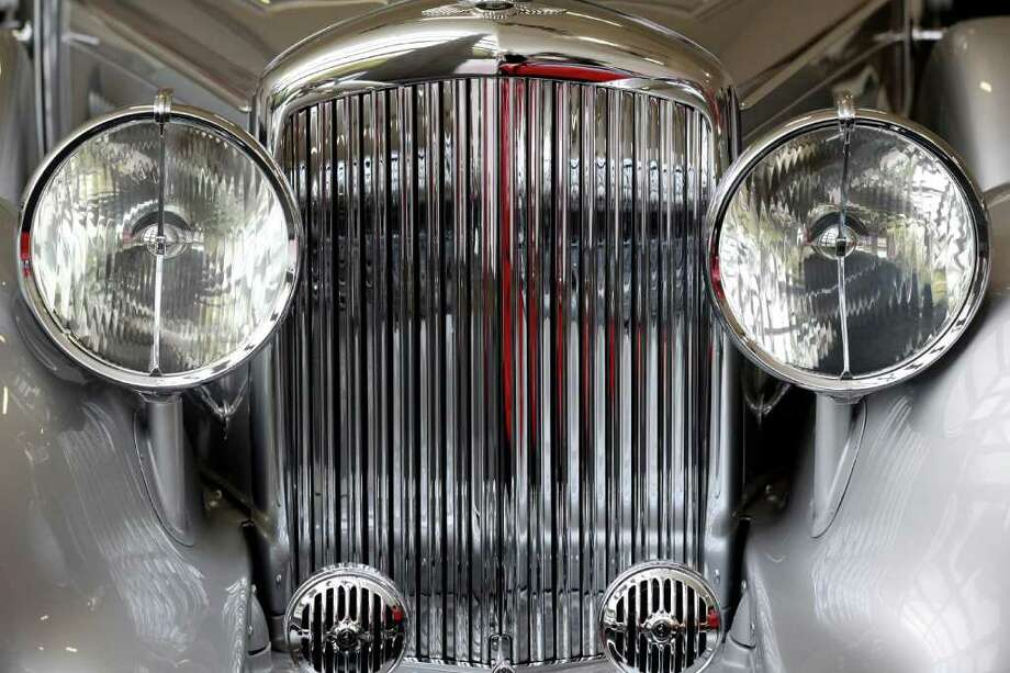 LONDON, ENGLAND - OCTOBER 27:  A detail view of a 1938 Bentley 4 1/4 Litre Cabriolet, which is up for auction with an estimated sale price of 220,000 GBP, at the 'Automobiles of London' rare car auction in Battersea Park on Ocotber 27, 2010 in London, England. Over 100 motor cars are to be auctioned including the original Aston Martin DB5 driven by Sean Connery in Goldfinger and Thunderball James Bond films which is expected to fetch over 3.5 million GBP.  (Photo by Oli Scarff/Getty Images) Photo: Oli Scarff, Getty Images / 2010 Getty Images