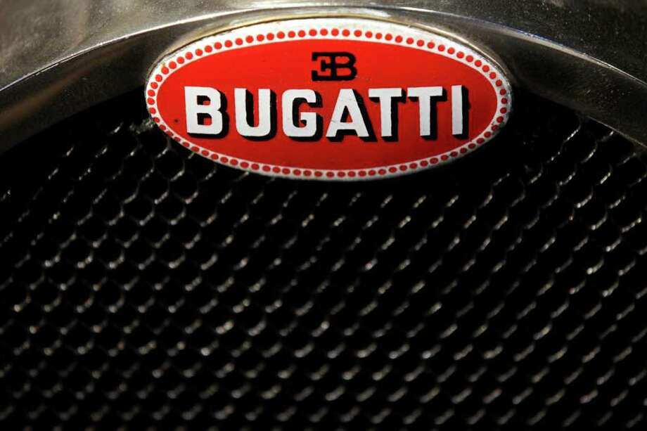 LONDON, ENGLAND - OCTOBER 27:  A detail view of the grill for a 1928 Bugatti Type 38 Tourer, whichis up for auction with an estimated sale price of 170,000 GBP, at the 'Automobiles of London' rare car auction in Battersea Park on Ocotber 27, 2010 in London, England. Over 100 motor cars are to be auctioned including the original Aston Martin DB5 driven by Sean Connery in Goldfinger and Thunderball James Bond films which is expected to fetch over 3.5 million GBP.  (Photo by Oli Scarff/Getty Images) Photo: Oli Scarff, Getty Images / 2010 Getty Images