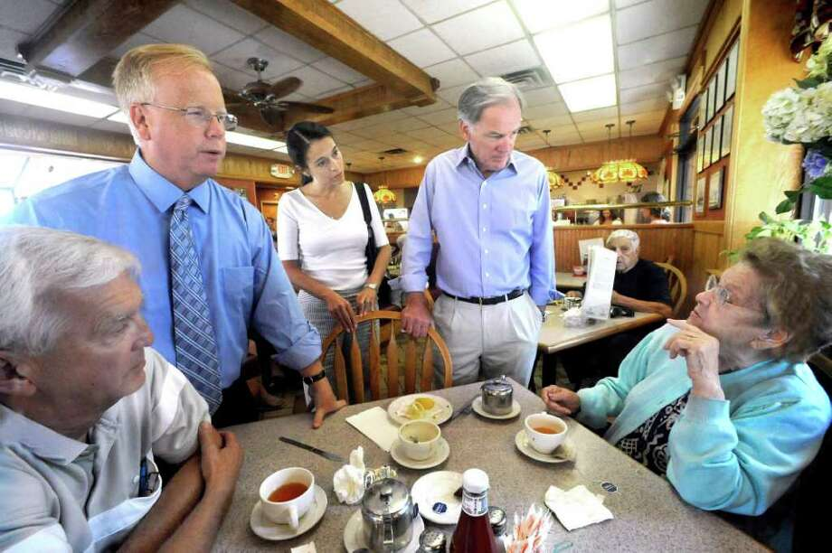 Mark Boughton Republican candidate for lieutenant governor left and Tom Foley Republican candidate for governor right center and his wife Leslie talk with Ed Miklaszewski 63 and his mother Tessie 93 at JK's Restaurant in Danbury Friday Aug 20 2010. Photo: Michael Duffy / The News-Times