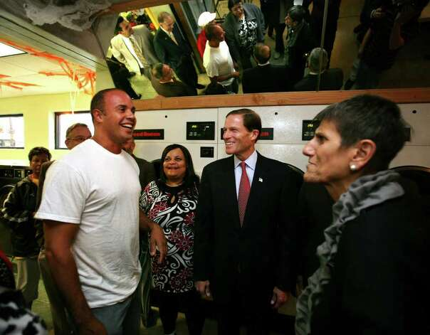 From left; Angelo Reyes, owner of People's Laundromat, talks with Alderman Migdalia Castro, senate candidate Richard Blumenthal, and Rep. Rosa DeLauro during a meet and greet walking tour of Hispanic-run businesses on Grand Street in New Haven on Tuesday, October 26, 2010. Photo: Brian A. Pounds / Connecticut Post