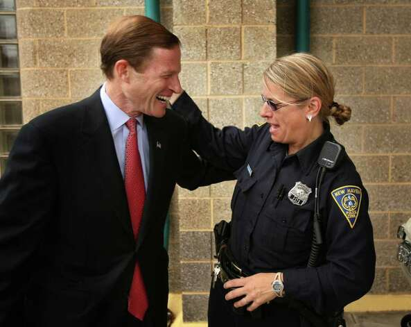 Senate candidate Richard Blumenthal, left, gets a hug from New Haven motorcycle officer Kristen Fitzgerald after receiving a union endorsement of his candidacy at the  police substation on Blatchley Avenue in New Haven on Tuesday, October 26, 2010. Photo: Brian A. Pounds / Connecticut Post