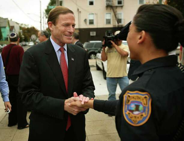 Senate candidate Richard Blumenthal greets Meriden police officer Jennifer Pierce while receiving the endorsement of police and fire unions at the police substation on Blatchley Avenue in New Haven on Tuesday, October 26, 2010. Photo: Brian A. Pounds / Connecticut Post