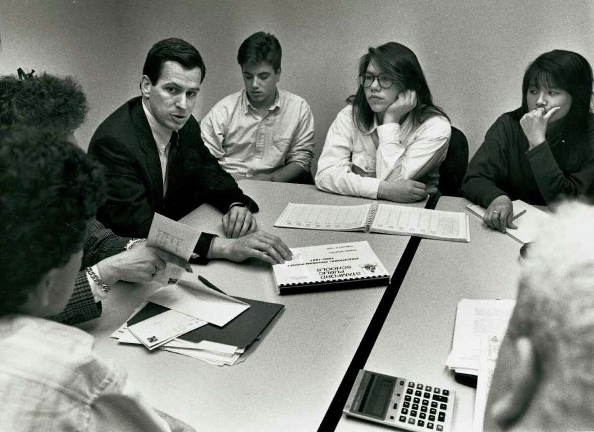1990: Dannel Malloy, third from left, Chairman of the Board of Finance, speaking to three Stamford HS students, from left to right, Josh Fedeli, Anna Norgren, and Emily Tsai. The three students walked out of school earlier that week to protest cuts to the education budget.