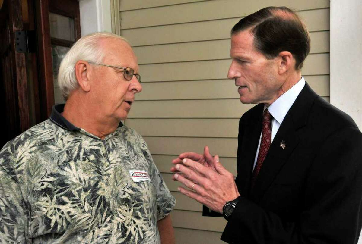 Richard Wajert, of Bethel, talks with State Attorney General Richard Blumenthal, who is running for U.S. Senate, during a visit to the Danbury home of Julie Kushner and Larry Morgan, Wednesday, Oct. 27, 2010.