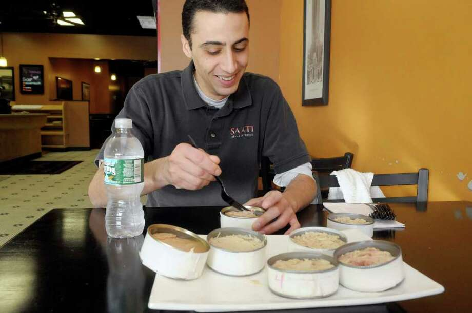 "Saati Deli & Catering owner Noam Saati agreed to try seven kinds of canned tuna for a blind taste test. The winner ""had good tuna flavor,"" he said, but was not overly fishy. (Paul Buckowski / Times Union) Photo: Paul Buckowski / 00010697A"