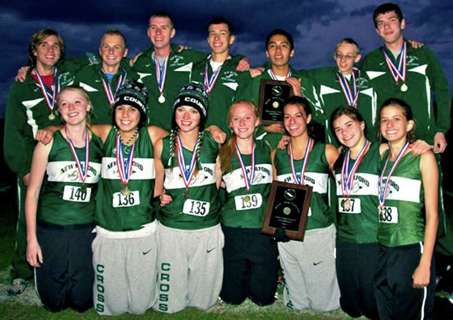 SPECTRUM/The New Milford High School boys' and girls' cross country teams won respective South-West Conference titles, Oct. 21, 2010 at Bethel High School. Photo: Trish Haldin / The News-Times Freelance