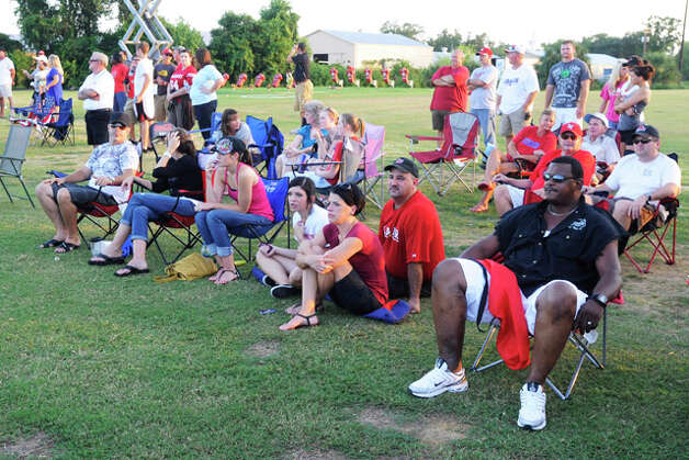Lamar football fans line the sidelines to get a view of scrimmage action on Saturday at the Vernon Glass Field of Champions.  Valentino Mauricio/The Enterprise