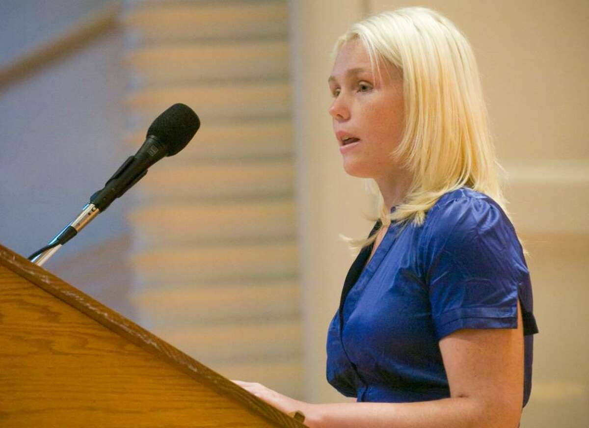"""Ashley Gilligan talks about her father Ronald Gilligan, a Cantor Fitzgerald employee who died in the World Trade Center, during the """"9-11 Remembrance"""" ceremony at Norwalk City Hall on Friday, Sept 11, 2009."""