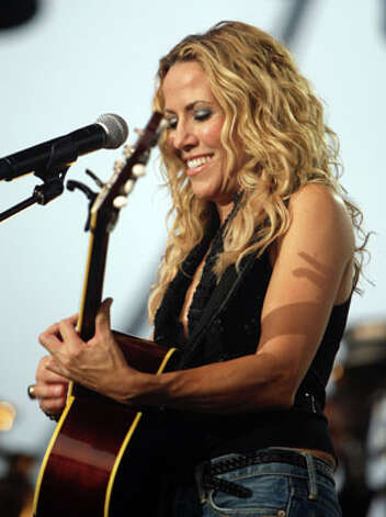 """100 Miles From Memphis"" by Sheryl Crow; Release Date: July 20"