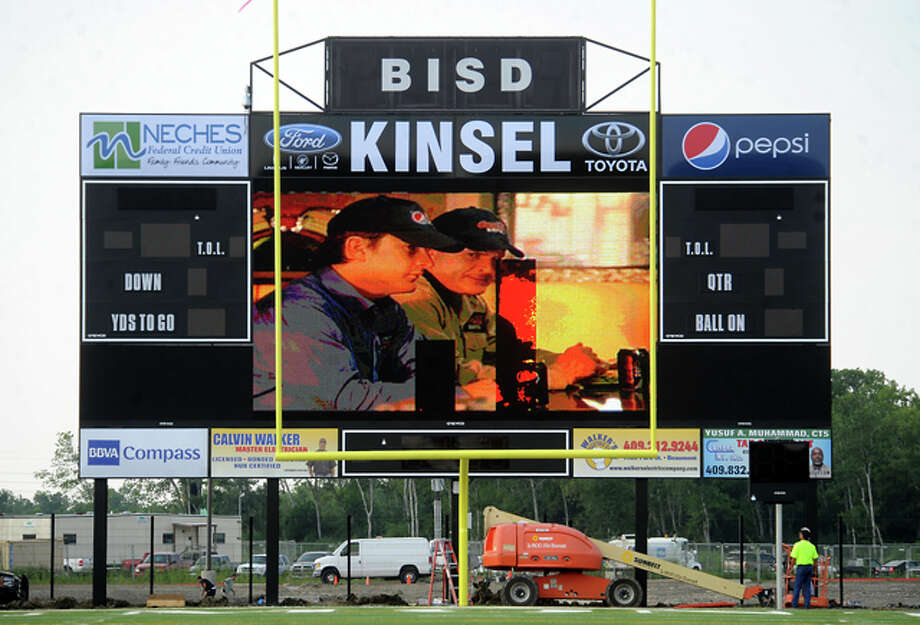 "The Carrol A. ""Butch"" Thomas Educational Support Center video scoreboard plays commercials and promotional videos during the open house in Beaumont, Thursday. While finishing touches are still being added, the new stadium is game day ready. Tammy McKinley/The Enterprise"