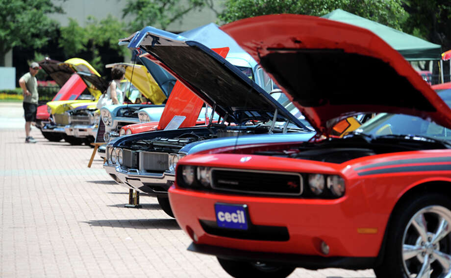 A wide variety of classic and custom cars are on display during the Bringin' Back Memories Car Show at Crockett Street in Beaumont, Saturday. Proceeds are designated to benefit the Humane Society of Southeast Texas and Meals on Wheels. Tammy McKinley/The Enterprise