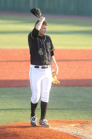Vidor pitcher Trae Hester takes a moment to regain his composure on the mound after Crosby scored three runs during the third inning of their playoff matchup  on Wednesday at Lamar's Vincent-Beck Stadium.  May 5, 2010. Valentino Mauricio/The Enterprise / Beaumont