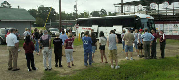 Parents, friends and fans wait to cheer the team on when they board the bus outside the field house.   The Jasper High School baseball team left for Austin Tuesday morning on a chartered bus from their field house.  Dave Ryan/The Enterprise