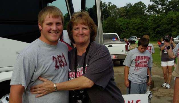 "Wynette Sowell, right, poses with her son, Derek ""Boomer"" Sowell, before he boarded the bus at the field house.  The Jasper High School baseball team left for Austin Tuesday morning on a chartered bus from their field house to play in the state final game.  Dave Ryan/The Enterprise"