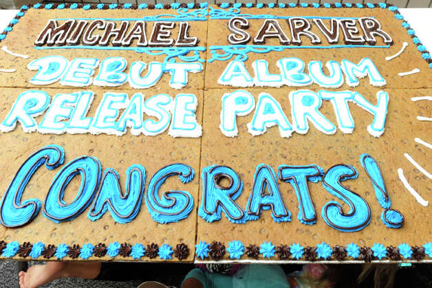 A large cookie-cake honored Michael Sarver, from Jasper, Texas, who was the tenth place finalist on the eighth season of American Idol, will be giving a free performance at Parkdale Mall. Saturday, July 24, 2010.  Valentino Mauricio/The Enterprise