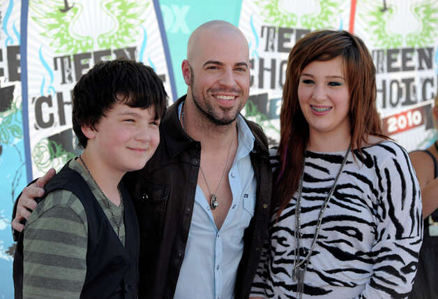 Chris Daughtry, center, and guests. 385510