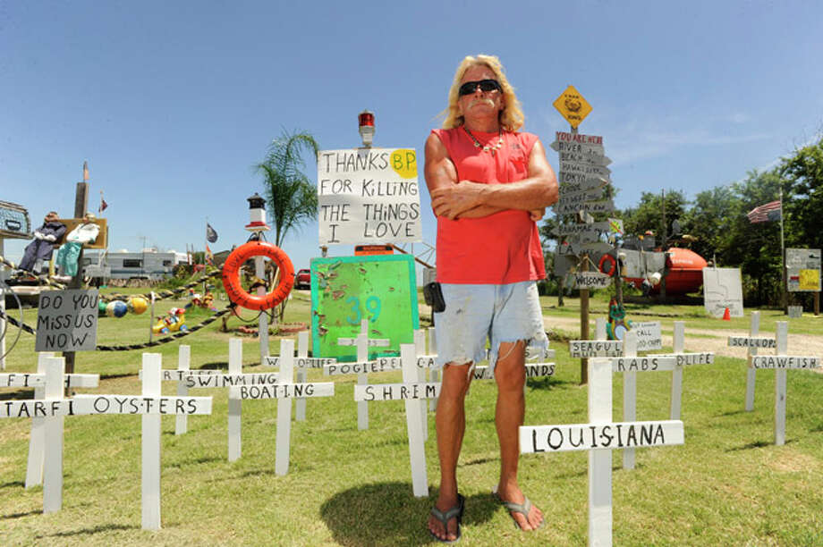 "Sabine Pass resident Michael ""Cappy"" Deslatte has compiled a heaping helping of junk he has turned into folk art. His yard, a drive- through mini theme park,  is loaded with hurricane debris that has been crafted into political statements and hilarious artwork. Valentino Mauricio/The Enterprise"