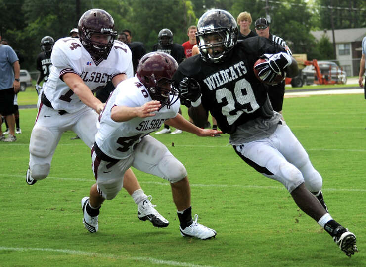 Kirbyville's LaFrederick Ford runs for yardage during a scrimmage against Silsbee at Kirbyville High