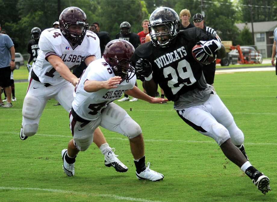 Kirbyville's LaFrederick Ford runs for yardage during a scrimmage against Silsbee at Kirbyville High School, Saturday. Tammy McKinley/The Enterprise