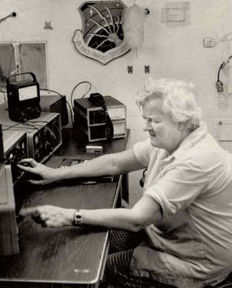 Mikie Lee readies her ham radio to relay emergency messages should Hurricane Anita cause a breakdown in normal communciations.
