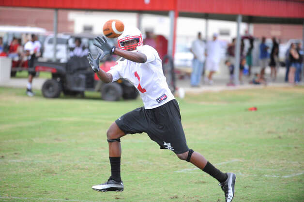 Cardinal wide receiver Marcus Jackson keeps his eye on the football during practice at the Vernon Glass Field of Champions during Lamar University's first football practice. Valentino Mauricio/The Enterprise