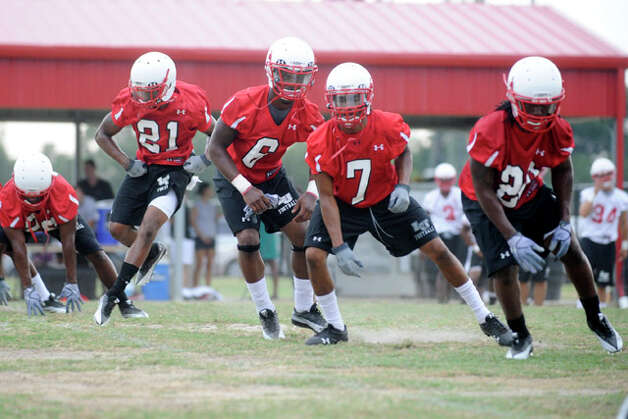 The Lamar University football team takes the field for warm up drills during their first day of practice at the Coach Vernon Glass Field of Champions.  Thursday, August 5, 2010. Valentino Mauricio/The Enterprise