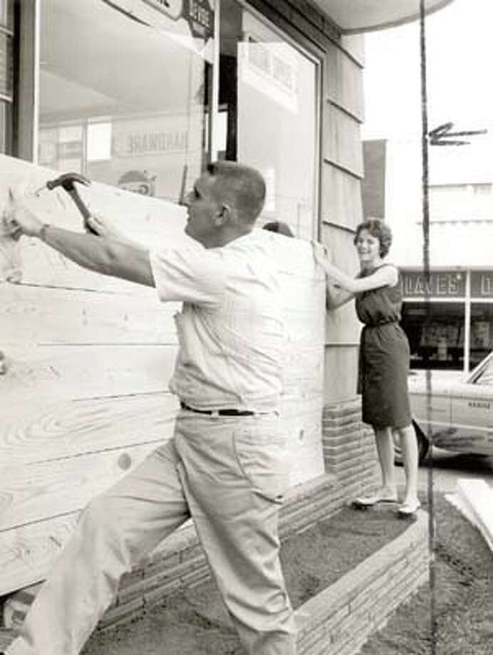 Sulphur- Ray Lavergne and Gayle Moss board up a Sulphur business window in the face of threats from Hurricane Hilda.