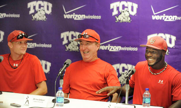 Lamar head coach Jim Gilligan, center, and players, Matison Smith, left, and Anthony Moore, right, share a moment of laughter during a press conference on Thursday afternoon at Texas Christian University's Lupton Stadium in Fort Worth. The Cardinals will play in Friday's NCAA tournament game against TCU at 7p.m.  Valentino Mauricio/The Enterprise