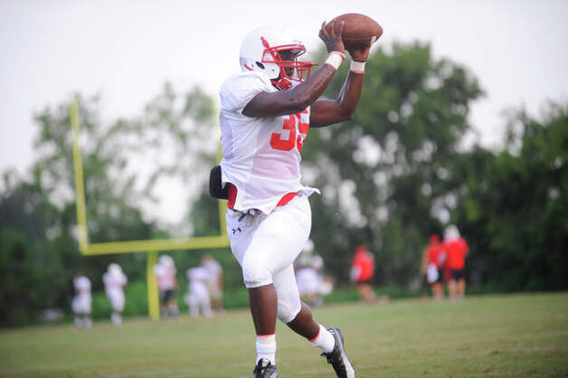 Cardinal running Jordan Nixon grabs a pass during team drills with other Lamar running backs at practice on Wednesday at the Vernon Glass Field of Champions.  August 11, 2010  Valentino Mauricio/The Enterprise