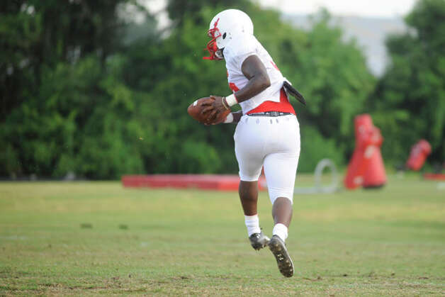 Cardinal running Jordan Nixon makes a run during team drills with other Lamar running backs on Wednesday at the Vernon Glass Field of Champions.  August 11, 2010  Valentino Mauricio/The Enterprise