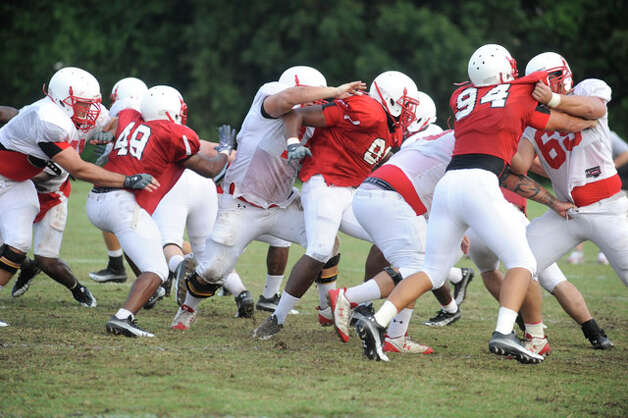 The Cardinals offensive and defensive lines clash during practice on Wednesday at the Vernon Glass Field of Champions.  August 11, 2010  Valentino Mauricio/The Enterprise