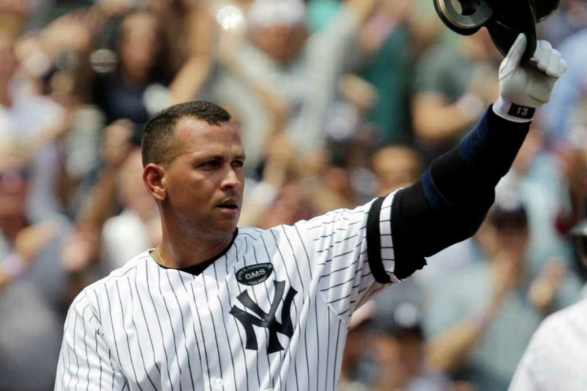 New York Yankees' Alex Rodriguez takes a curtain call after hitting his 600th career home run in the first inning of Wednesday afternoon's game against the Toronto Blue Jays at Yankee Stadium in New York. Kathy Willens/The Associated Press