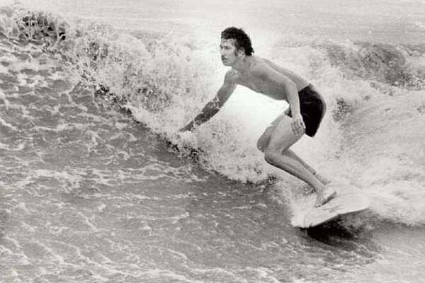 Michael Estrada rides the waves at High Island.
