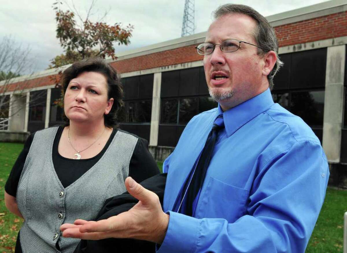 Johnny Smith, and his wife Cheryl Smith, from Conway, S.C., speak to reporters following a custody hearing in Warren County Family Court Wednesday, Oct. 27. (John Carl D'Annibale / Times Union)