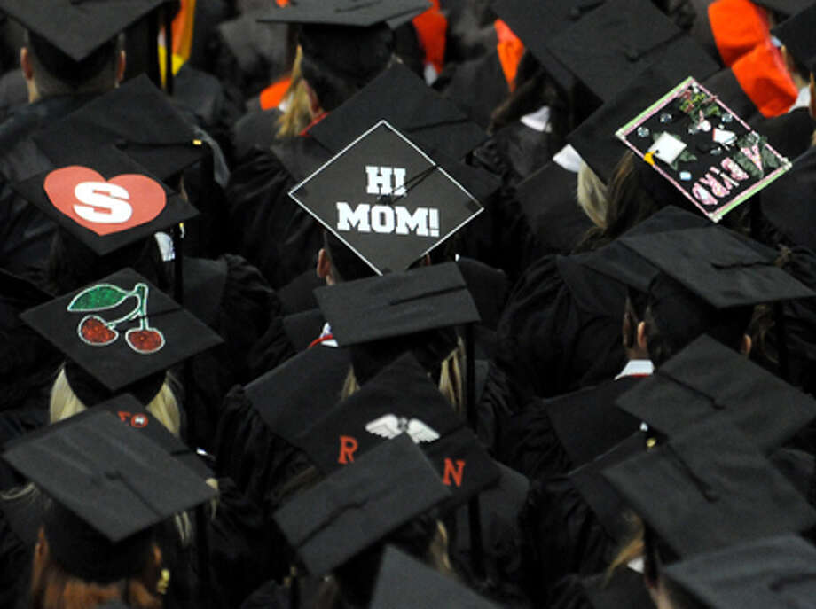 Some graduates decorate their caps to express their individuality or send messages during graduation ceremonies in the Montagne Center at Lamar University in Beaumont, Saturday. Tammy McKinley/The Enterprise / Beaumont