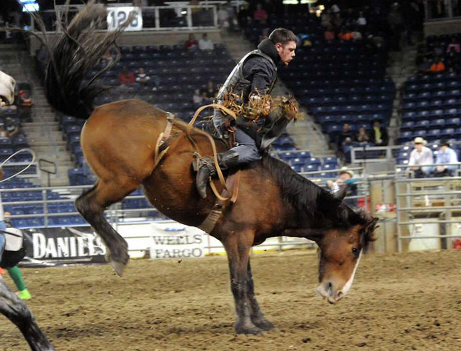James Bond rides in the bareback competition during the 2010 YMBL Championship Rodeo at theSouth Texas State Fair at Ford Park in Beaumont, Friday, Tammy McKinley/ The Enterprise