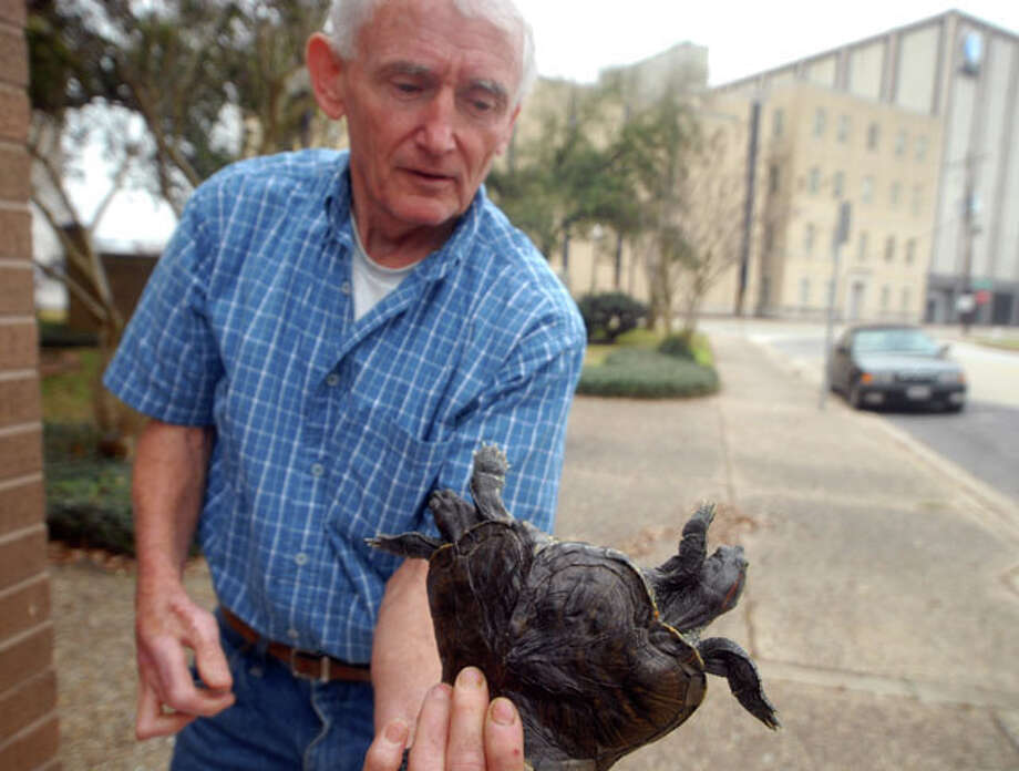 Fred Lally of West Fork, Ark., shows off a two-headed turtle, part of Lally?s Oddity Exhibit on view at Heritage Festival in Nederland near the carnival mid-way. Beth Rankin/The Enterprise