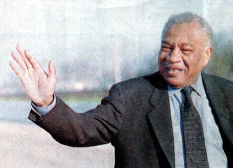 Theodore Johns, Sr. waves to the crowd as Grand Marshall of the Martin Luther King, Jr. parade in Beaumont in 1999. Enterprise file photo