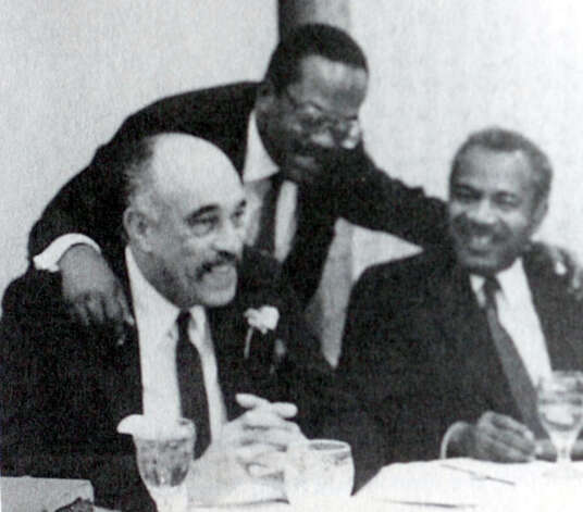 Elmo Willard, left, Judge John Paul Davis, and Thoedore Johns, Sr. at in banquet in Beaumont. Date unknown. Photo provided by Tyrrell Historical Library